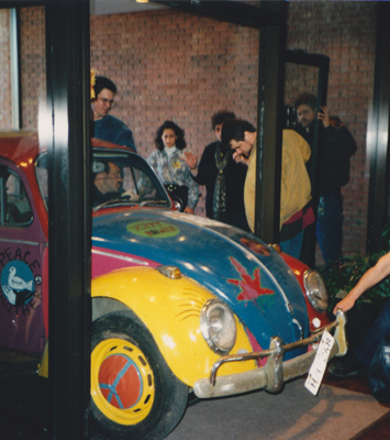 Volkswagen bug being brought into the lobby by Krannert Center staff